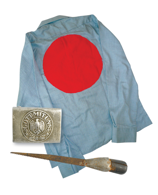 Memorabilia collected from the camps include a shirt with a red circle indicating a prisoner, a German Army buckle and a homemade knife discovered in Camp 133 at Lethbridge. [PHOTO: HOMEFRONT ARCHIVES & MUSEUM, REGINA; GALT MUSEUM & ARCHIVES, LETHBRIDGE, ALTA.]