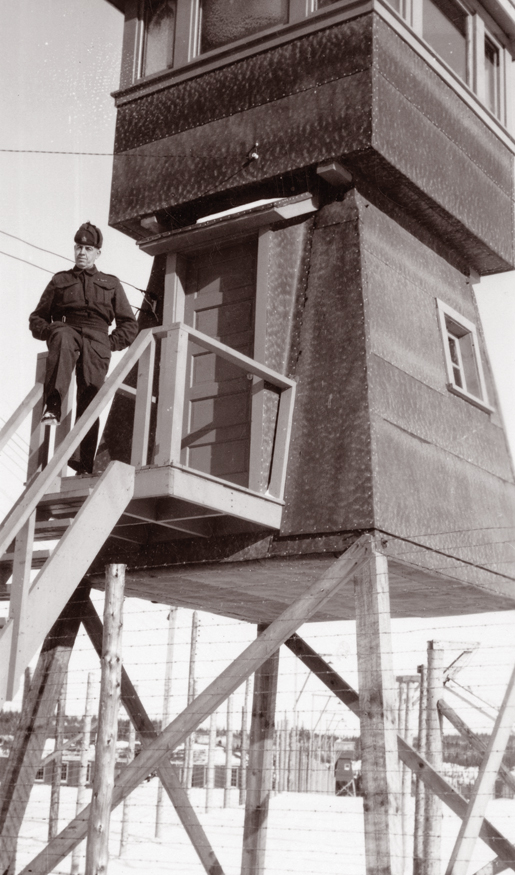 A member of the Veterans Guard of Canada mans his position at a guard tower in Monteith, Ont. [PHOTO: CANADIAN WAR MUSEUM—20050128-017]