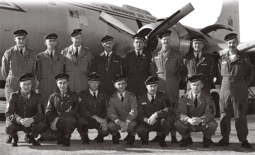 Canadian airmen with French naval aviators in front of an Argus aircraft.