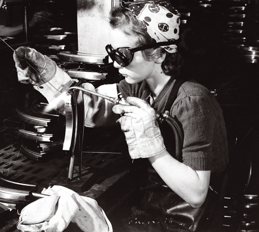 A welder works on a Bren gun at John Inglis Company Ltd., 1942.