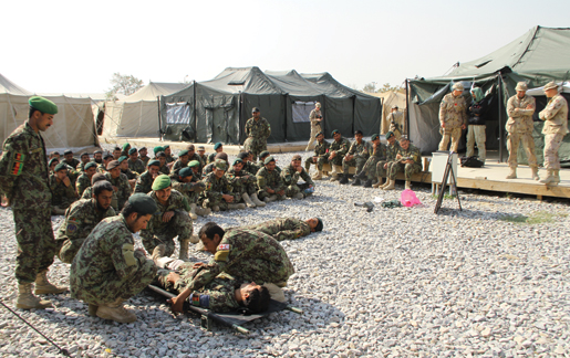 Afghan army recruits receive first aid  training in Kabul as Canadians look on.