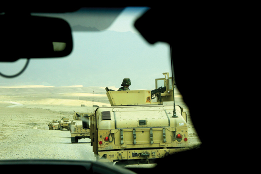 Afghans practice convoy operations on a plateau above Kabul.