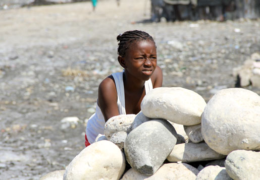 A girl watches children play in Cité Soleil, Port-au-Prince, Haiti. [PHOTO: DAN BLACK]