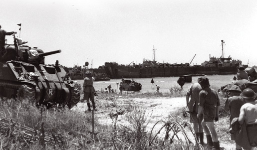 1st Canadian Division hauling transport up from the beach, Pachino, Sicily.