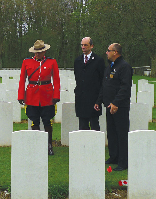 RCMP Constable Jason Lilly, Veterans Affairs Minister Steven Blaney and veteran Reno St-Germain at Canadian Cemetery No. 2.