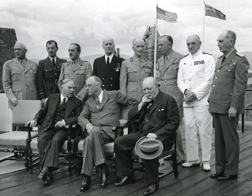 Prime ministers Mackenzie King, Winston Churchill with President Franklin D. Roosevelt and the British and American Chiefs of Staff during the Quadrant Conference.