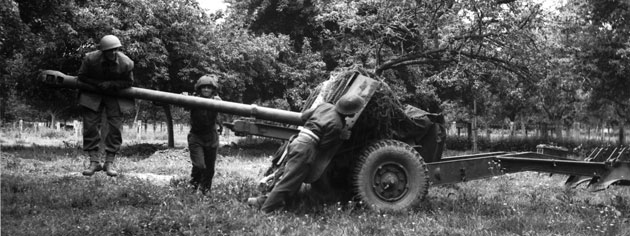 A 17-pounder anti-tank gun is moved into position, June 1944. [PHOTO: KEN BELL, LIBRARY AND ARCHIVES CANADA—PA128793]