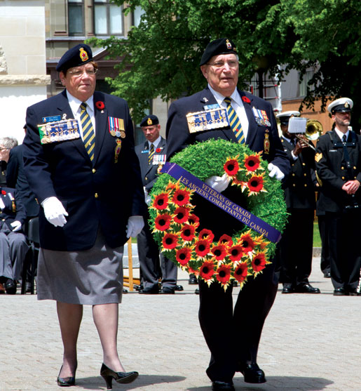 Dominion President Pat Varga, accompanied by Past President Wilf Edmond, place a wreath. [PHOTO: DAN BLACK]