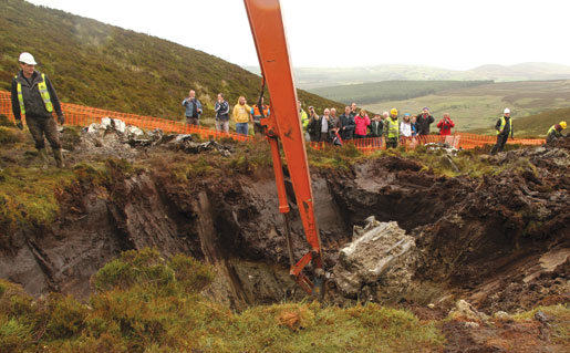 A Spitfire's engine is raised from the peat in County Donegal, Ireland. [PHOTO: JONNY McNEE]