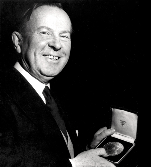 Lester B. Pearson displays his Nobel Peace Prize, December 1956. [PHOTO: ASSOCIATED PRESS]