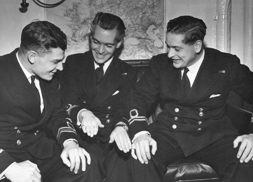 Lieutenant-Commander Digby Cosh (left) and lieutenants A.N. Pym and H.P. Wilson share a moment after the 1944 raid on Tirpitz. [PHOTO: COURTESY YOLANDE MCLEAN]