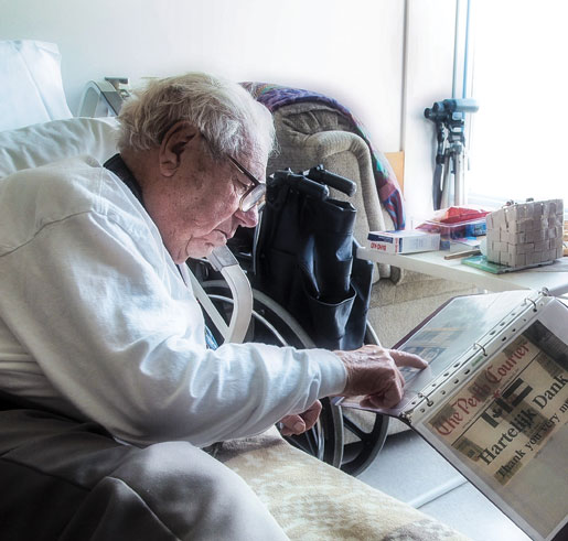 A newspaper clipping brings back some memories for Ted. [PHOTO: DAN WARD]