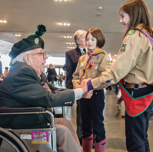 Scouts greet Ted Patrick at the Canadian War Museum. [PHOTO: DAN WARD]