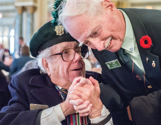 Ted and a fellow veteran shake hands during the lunch at the Fairmont Chateau Laurier Hotel. [PHOTO: DAN WARD]