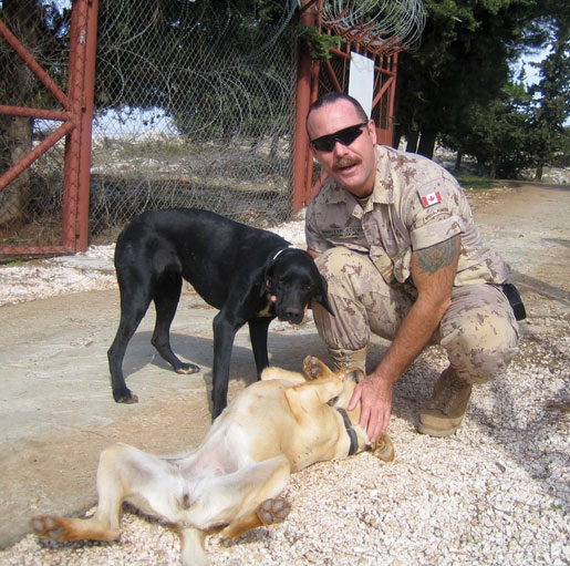 Wolf with Gwynn and Ghajar, the base dogs. [PHOTO: COURTESY CYNTHIA HESS-VON KRUEDENER]