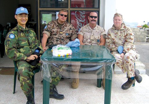 Major Du Zhaoyu, Lieutenant Jarno Mäkinen, Major Paeta Hess-von Kruedener and Major Matina Jewell. [PHOTO: COURTESY CYNTHIA HESS-VON KRUEDENER]