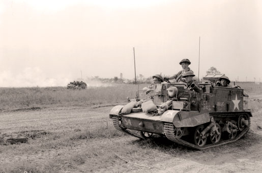 A Universal Carrier advances near Cintheaux, France, August 1944. [PHOTO: KEN BELL, LIBRARY AND ARCHIVES CANADA—PA113651]