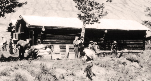 The Mad Trapper of Rat River, Albert Johnson (light haired man near tree-centre). [PHOTO: LIBRARY AND ARCHIVES CANADA—C039883]