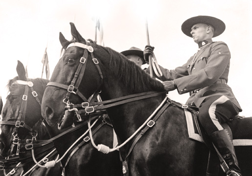 Inspection of Royal Canadian Mounted Police Coronation Contingent and Review of Musical Ride, April 1953. [PHOTO: LIBRARY AND ARCHIVES CANADA—PA144092]