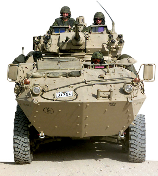 Soldiers in a armoured reconnaissance vehicle, Kandahar, Afghanistan. [PHOTO: SGT. GERRY PILOTE, DGPA/J5PA COMBAT CAMERA—ISD02-3013a]