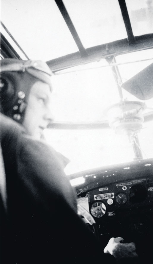 Flying Officer Robert Fowler in the cockpit of his Mitchell bomber of No. 226 Squadron, RAF, 1944. [PHOTO: LIBRARY AND ARCHIVES CANADA—PA123031]