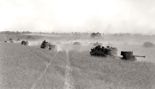 Vehicles from the 3rd Canadian Division kick up dust as they advance near Bretteville-le-Rabet. [PHOTO: DONALD I. GRANT, LIBRARY AND ARCHIVES CANADA—PA116536]