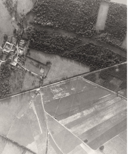 Aerial photo before the bombing at Quesnay Woods. [PHOTO: LAURIER CENTRE FOR MILITARY STRATEGIC AND DISARMAMENT STUDIES AIR PHOTO COLLECTION]