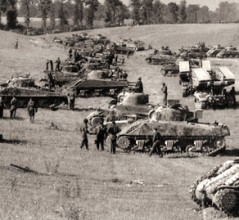 Tanks of the Fort Garry Horse prepare for a noon attack from Bretteville-le-Rabet, France, August 1944. [PHOTO: DONALD I. GRANT, LIBRARY AND ARCHIVES CANADA—PA113658]