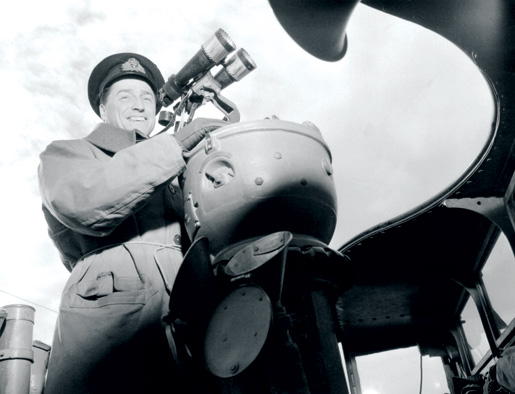 Lieutenant-Commander Desmond W. Piers on the Canadian destroyer Restigouche during an April 1944 convoy escort. [PHOTO: LIEUT. JOHN DANIEL MAHONEY, LIBRARY AND ARCHIVES CANADA—PA136286]