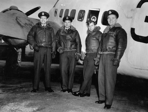 Pilot Officer A.W. Bell, PO D.S. Lave, Flying Officer H.W. Middleton and FO N.F. Wenzel pose next to a Hudson while serving in Iceland with a RAF meteorological squadron. [PHOTO: NATIONAL DEFENCE—PL33820]