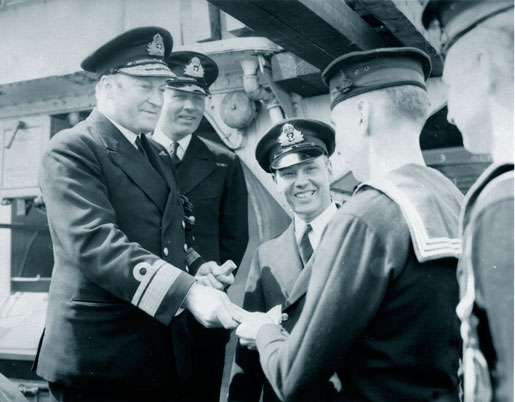 Rear-Admiral Leonard Murray presents awards to the crew  of HMCS St. Croix for sinking U-90 in July 1942. [PHOTO: LIBRARY AND ARCHIVES CANADA—PA037456]