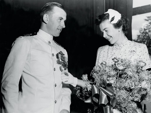 Lieutenant-Commander Joseph MacBrien and his wife after the Canadian naval aviator is presented with an American Distinguished Flying Cross in 1954. [PHOTO: CANADIAN FORCES—O-7147]