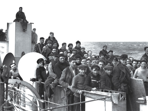 Merchant seamen crowd the upper deck of HMCS Shediac. The men were rescued after their respective ships were lost in the battle for convoy ONS 92 in May 1942. [PHOTO: COURTESY MARC MILNER]