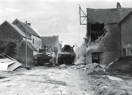 Tanks of the South Alberta Regiment—one apparently crippled—in St. Lambert-sur-Dives, Normandy, August 1944. [PHOTO: DONALD I. GRANT, LIBRARY AND ARCHIVES CANADA—PA116522]