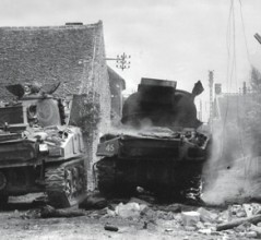 Tanks of the South Alberta Regiment in St. Lambert-sur-Dives, Normandy, August 1944. [PHOTO: DONALD I. GRANT, LIBRARY AND ARCHIVES CANADA—PA116522]