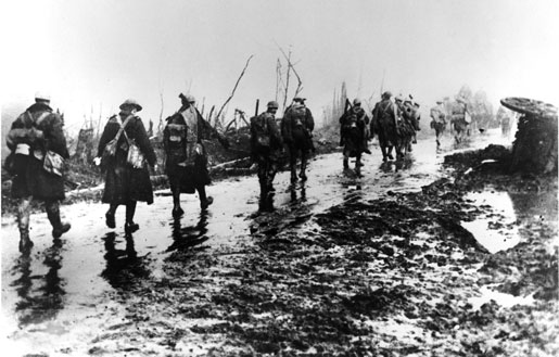 Tired, mud-spattered soldiers leave the Somme in the fall of 1916. [PHOTO: LIBRARY AND ARCHIVES CANADA—PA207187]