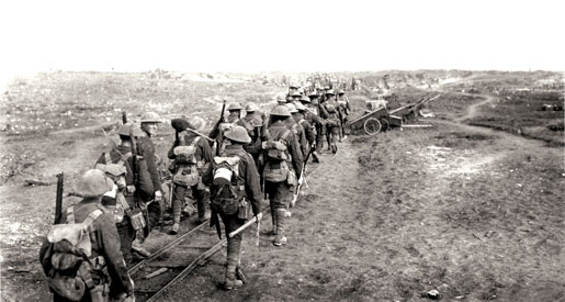 Canadian soldiers, some carrying picks and shovels, follow a light rail line on the Somme, September 1916. [PHOTO: DEPARTMENT OF NATIONAL DEFENCE/LIBRARY AND ARCHIVES CANADA—PA000682]