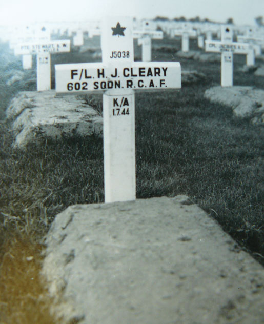 The grave of the young airman. The Commonwealth War Graves Commission later installed a permanent headstone. This temporary marker gives a date of death of July 1, 1944. The date of death was later updated to July 8, 1944. [PHOTO: COURTESY LYNDA MACPHEE]
