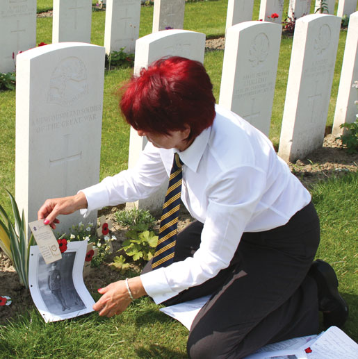 Linda Kohut at the grave of Private William Dodds, Tyne Cot Cemetery. [PHOTO: SHARON ADAMS]