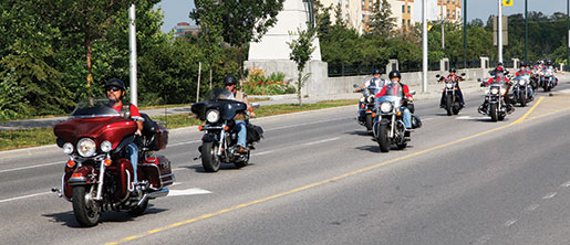 The bikers arrive in Kanata. [PHOTO: ADAM DAY]