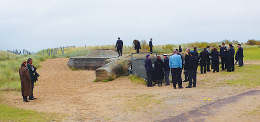Students and veterans explore a German bunker on Juno Beach. [PHOTO: SHARON ADAMS]