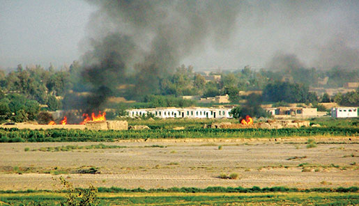 The infamous White School under attack during Operation Medusa, September 3, 2006. [PHOTO: ADAM DAY]