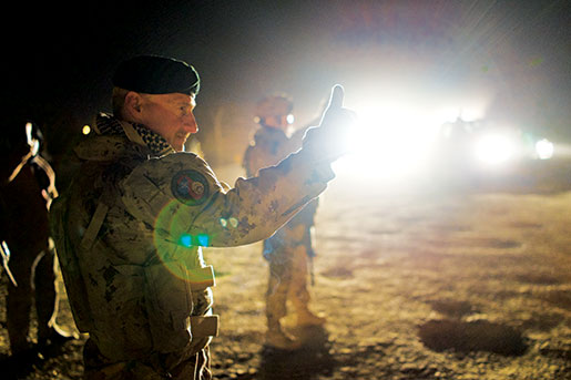 Colonel Ian Hope watches a newly trained Afghan battalion deploy, March 2013. [PHOTO: ADAM DAY]