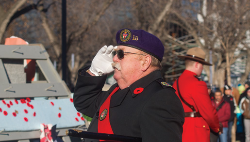 Sergeant-at-Arms Rick Monahan salutes. [PHOTO: TOM MacGREGOR]