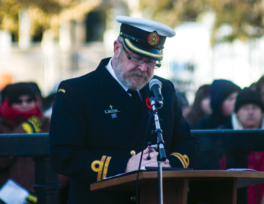 Navy Lieutenant James Balfour leads the service. [PHOTO: TOM MacGREGOR]