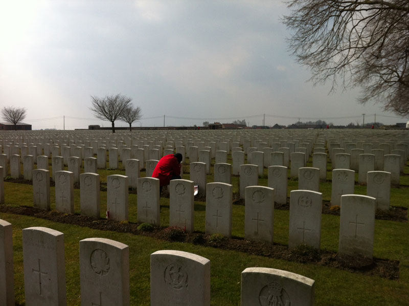Michael O'Sullivan pays his respects at Poelcappelle British Cemetery. [PHOTO: TOM O'SULLIVAN]