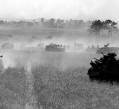 The 3rd Canadian Division advances south  of Bretteville-le-Rabet, France, Aug. 14, 1944. [PHOTOS: DONALD I. GRANT, DEPARTMENT OF NATIONAL DEFENCE/LIBRARY AND ARCHIVES CANADA—PA116536]