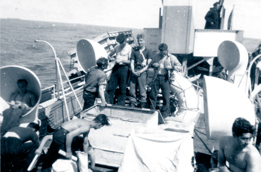 Sailors on board HMCS Sackville, mid-ocean off the Azores. [PHOTO: LEGION MAGAZINE ARCHIVES]