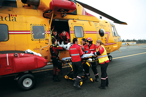 During the Sar Tech exercise in St. John's, paramedics unload the injured from a Cormorant helicopter. [PHOTO: ADAM DAY]