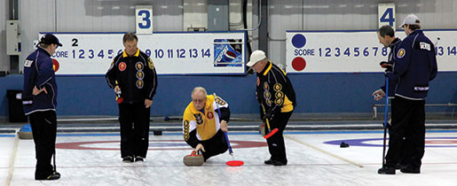 Manitoba's Greg Thompson lets go a rock during the final game. [PHOTO: ADAM DAY]